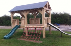 An example of how a timber shelter can be converted in to a kids climbing frame.